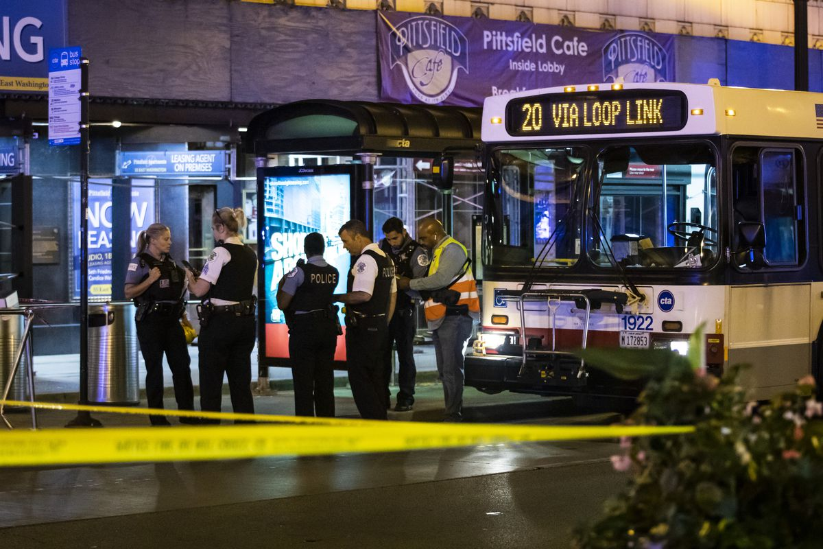 Chicago police investigate in the first block of East Washington Street in the Loop, where a CTA bus driver was physically attacked and then shot, Saturday night, Sept. 4, 2021.