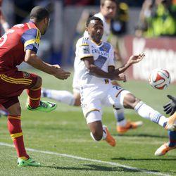 Real Salt Lake forward Alvaro Saborio (15) scores a goal on the Los Angeles Galaxy defense during a game at Rio Tinto Stadium on Saturday, March 22, 2014.