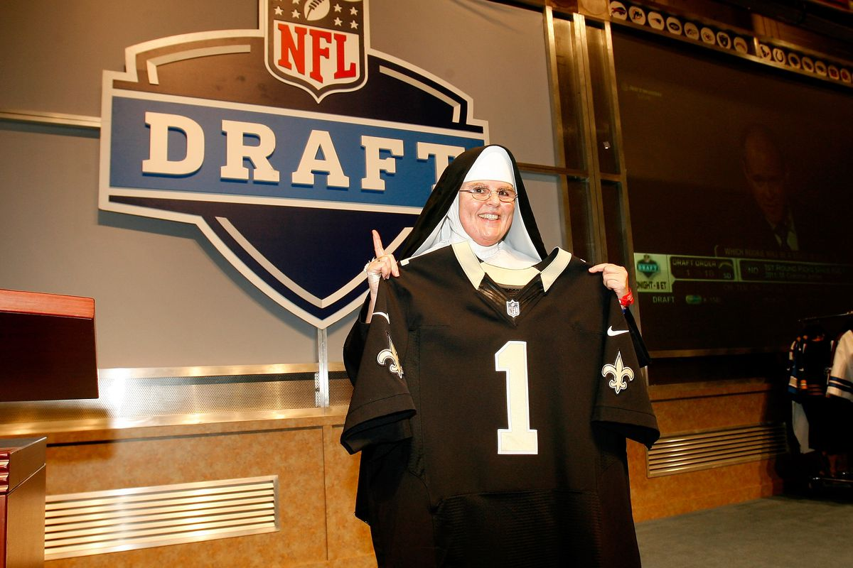 NEW ORLEANS, LA - A fan in a nun's habit poses with a New Orleans Saints jersey at the Super Bowl XLVII NFL Experience at the Ernest N. Morial Convention Center.