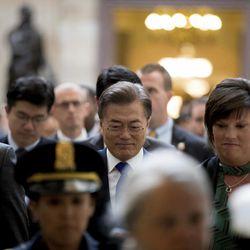 South Korean President Moon Jae-in, center, arrives to meet with Senate leadership on Capitol Hill in Washington, Thursday, June 29, 2017.