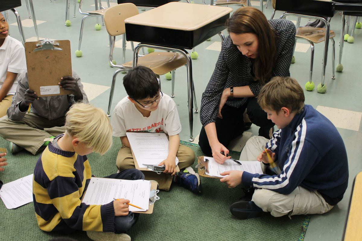 Katie Baker leads her third-graders in a reading exercise.