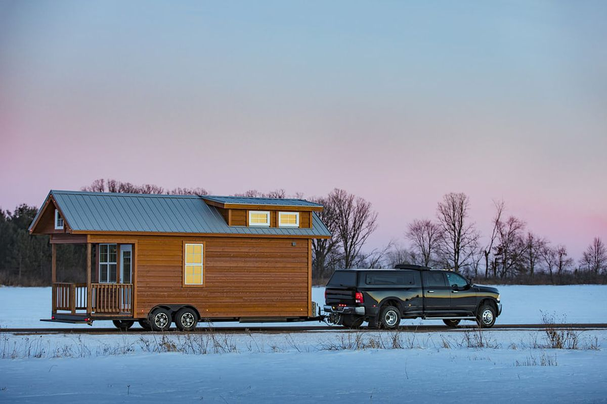 New Tiny House Goes Traditional With Porch, Cute Windows