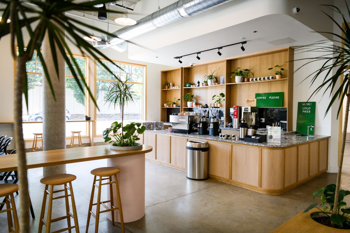 An espresso counter is surrounded by living plants at Lolo Pass