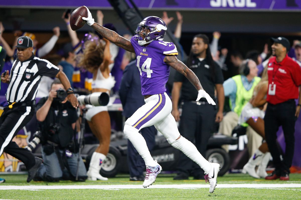 Stefon Diggs #14 of the Minnesota Vikings scores a touchdown.