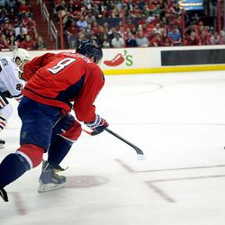 Ovechkin and Smith Race For Puck