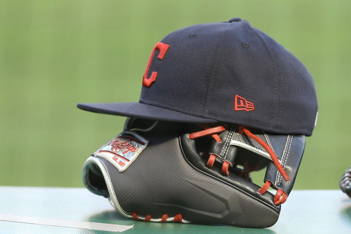 Cleveland Indians hats and glove on the dugout rail against the Pittsburgh Pirates during the third inning at PNC Park.