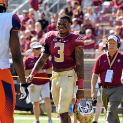 RS SO DB Derwin James, team captain, walking to middle field for the handshake and coin flip.