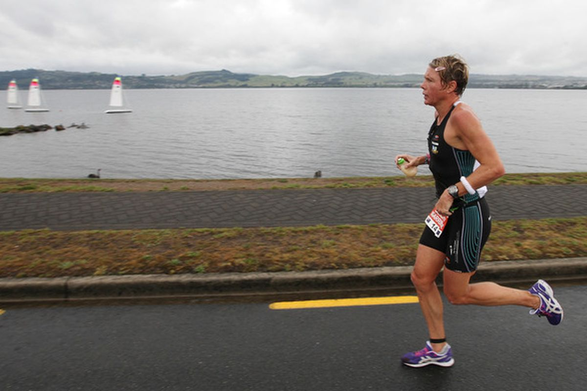 TAUPO, NEW ZEALAND - MARCH 05:  Samantha Warriner of New Zealand runs around Lake Taupo during the 2011 Taupo Ironman on March 5, 2011 in Taupo, New Zealand. (Photo by Sandra Mu/Getty Images)