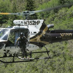 A Utah Department of Public Safety helicopter makes a surveillance run on Monday, June 5, 2017, as crews try to recover the body of a 22-year-old hiker who fell in Bell Canyon. Siaosi Brown's body was spotted in the lower falls of the canyon. His body was trapped on some logs in the middle of the waterfall, Unified Police Lt. Brian Lohrke said.