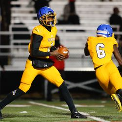 Simeon's Jacquez Woodland (1) rolls out with the ball during the game against Morgan Park.