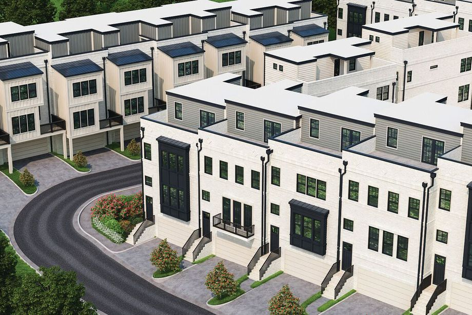 A rendering of white townhomes with roof decks.