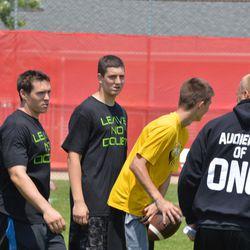 Jim Leonhard (second from left) advises a camp participant Saturday.