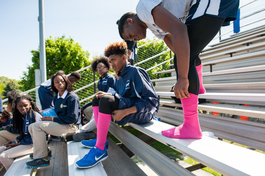 Marquese Simpson, 17, and Eric March, 16, wear pink socks during the track meet Thursday. | Max Herman/For the Sun-Times