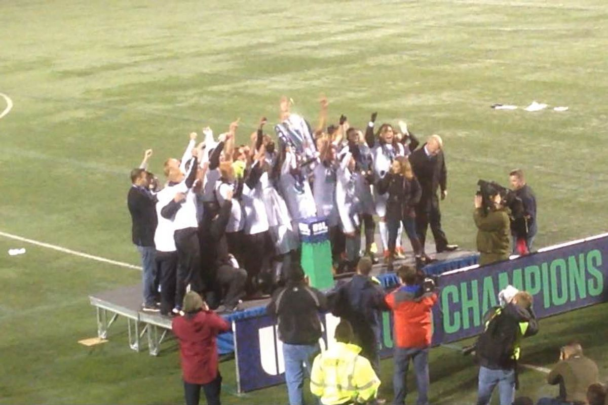 Rochester captain Tony Walls lifts the USL trophy after the game