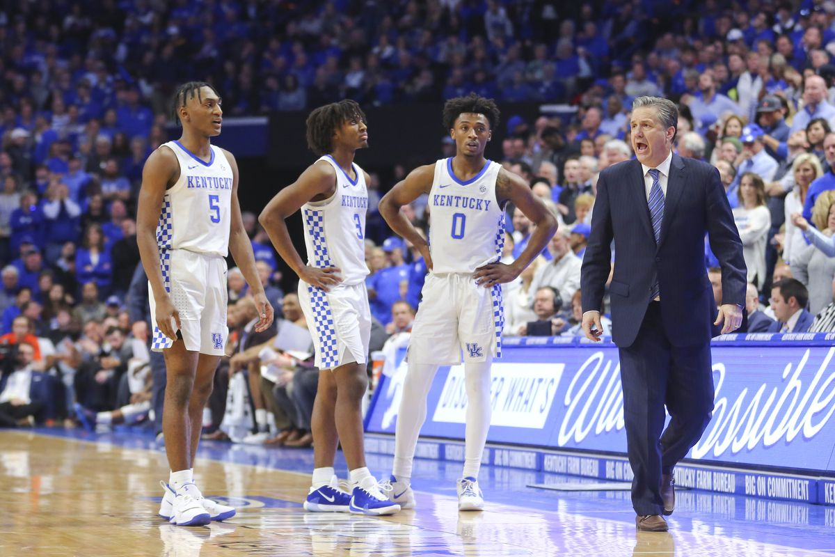 Kentucky Wildcats head coach John Calipari talks with guard Immanuel Quickley guard Tyrese Maxey and guard Ashton Hagans during a time out in the game against the Auburn Tigers in the second half at Rupp Arena.