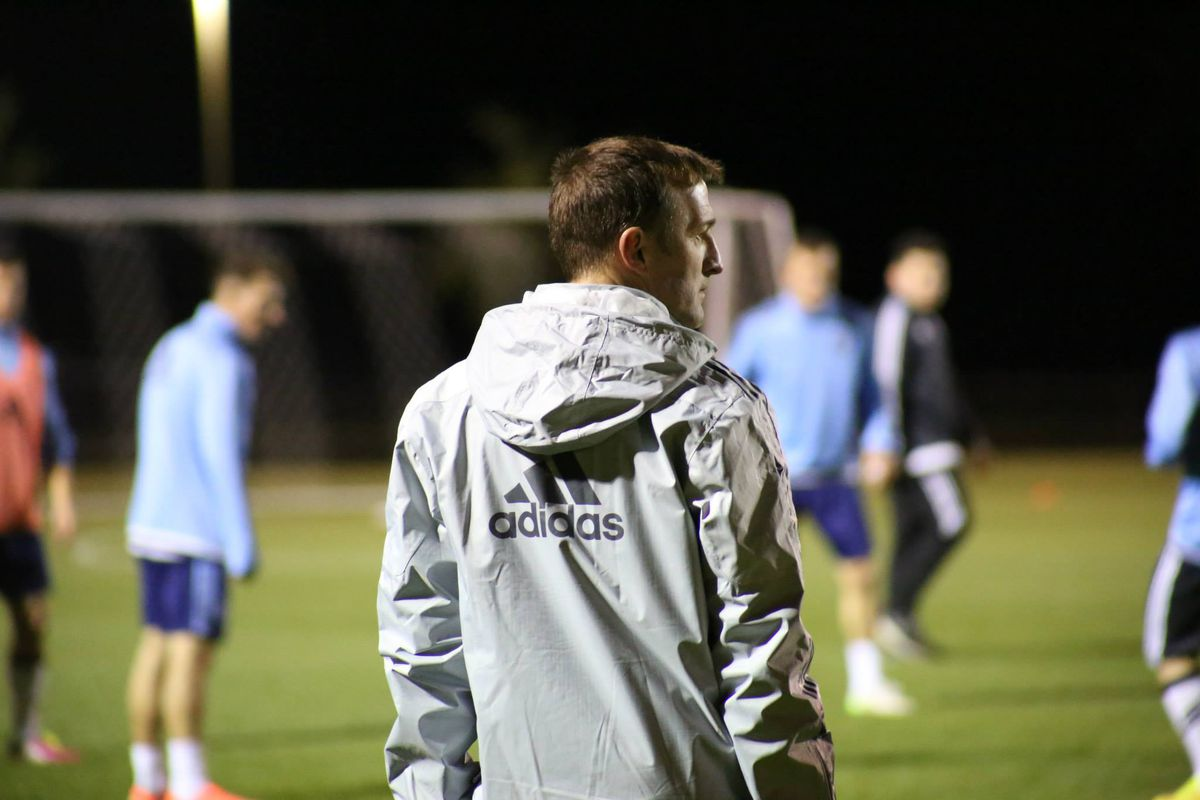 Jason Kreis looks over New York City players in the first day of preseason