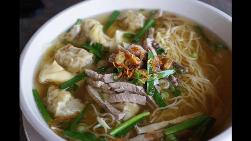 A closeup of a bowl of pho at District 1 Saigon