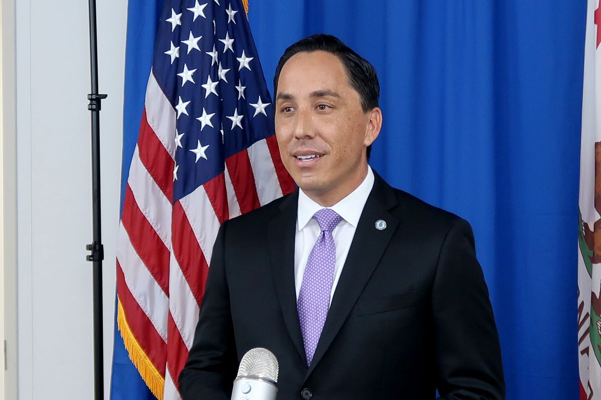 San Diego Mayor Todd Gloria stands in front of the American flag