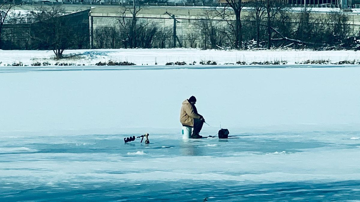 An ice angler sits on a partially snow-covered Axehead Lake on Friday before the storm. Reader provided