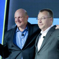 Steve Ballmer, left, Chairman and CEO of Microsoft, and Stephen Elop, CEO of Nokia, introducee Nokia's newest smartphone, the Lumia 920, equipped with Microsoft's Windows Phone 8, Wednesday, Sept. 5, 2012 in New York. Nokia revealed its first smartphones to run the next version of Windows, a big step for a company that has bet its future on an alliance with Microsoft.
