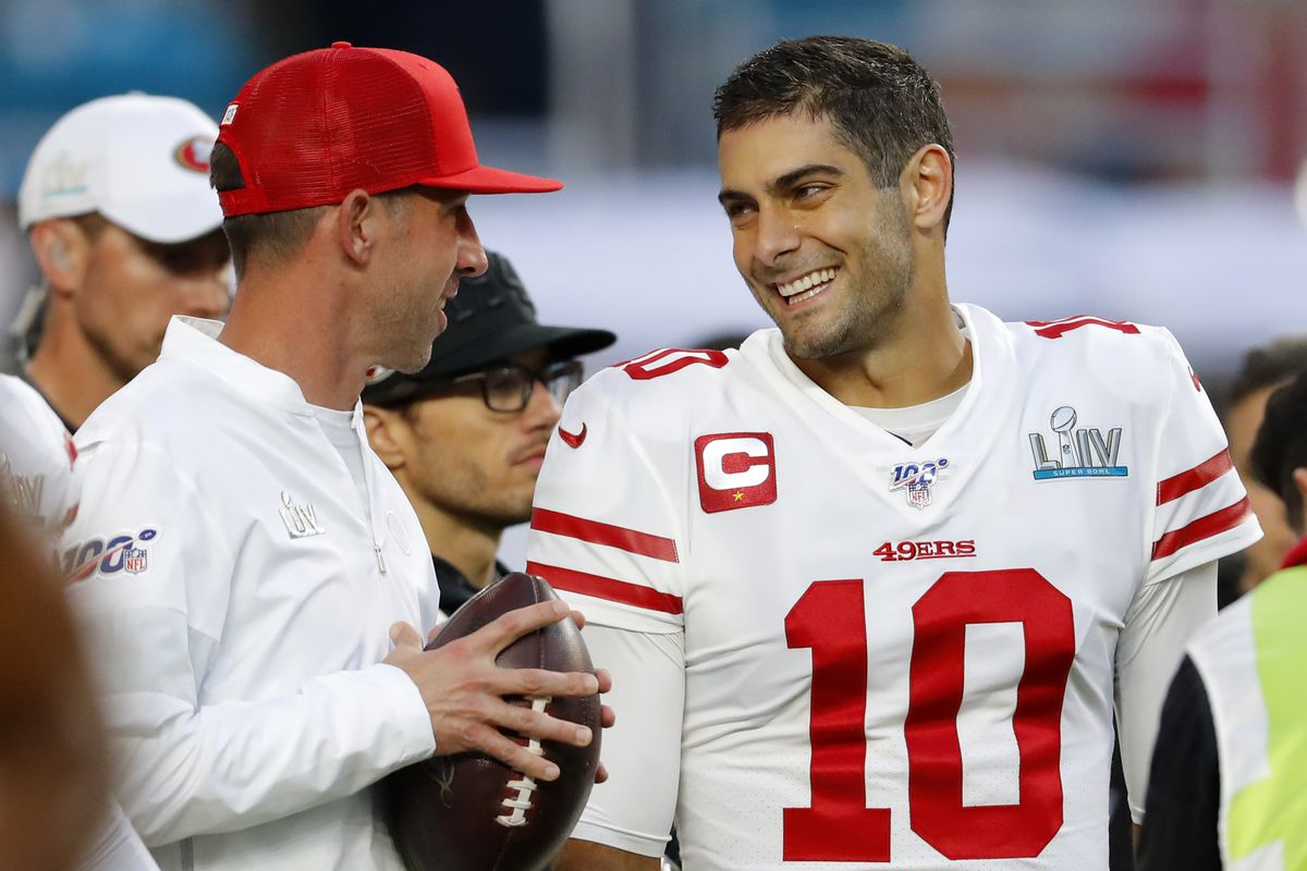 Head coach Kyle Shanahan of the San Francisco 49ers talks with Jimmy Garoppolo prior to Super Bowl LIV against the Kansas City Chiefs at Hard Rock Stadium on February 02, 2020 in Miami, Florida.