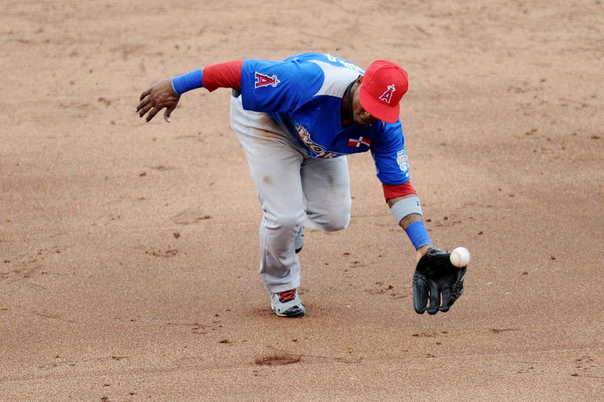 July 8, 2012; Kansas City, MO, USA; World infielder Jean Segura is unable to field a ground ball during the third inning of the 2012 All Star Futures Game at Kauffman Stadium.  Mandatory Credit: Peter G. Aiken-US PRESSWIRE