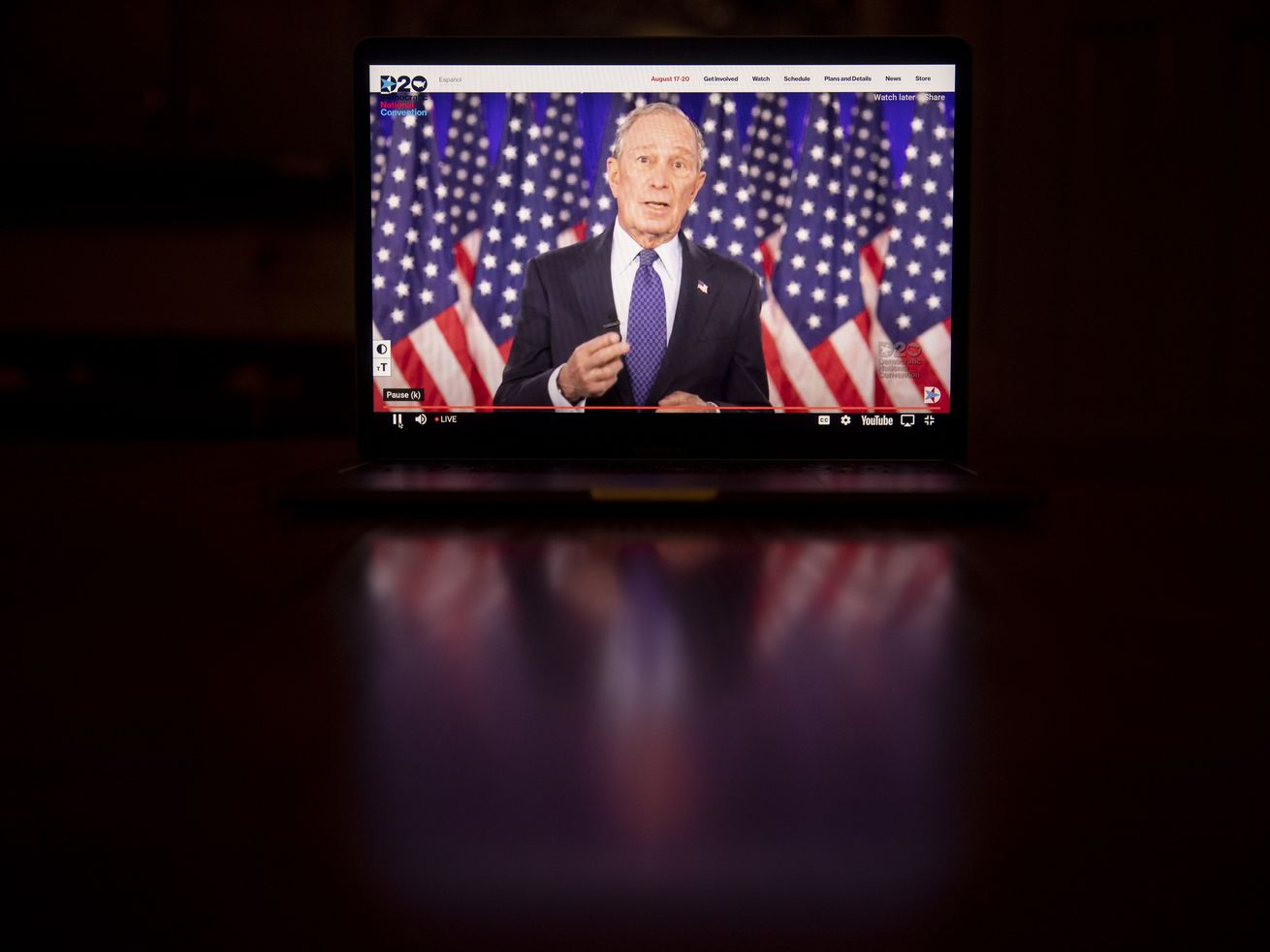 Mike Bloomberg speaking on a screen.