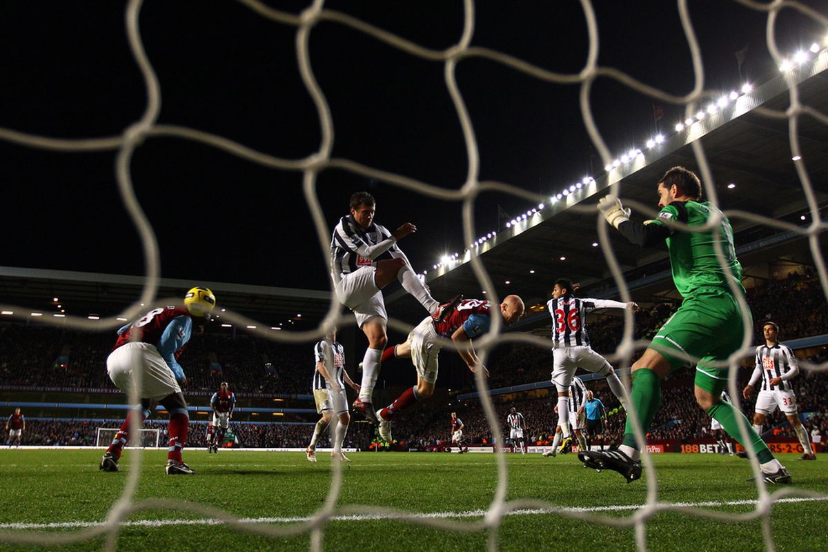 Emile Heskey scores the second goal of the day for Aston Villa. (Image by Richard Heathcote/Getty Images)