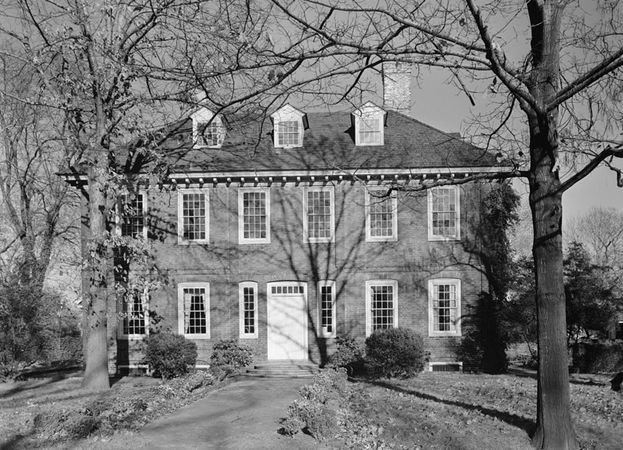 The exterior of Stenton Mansion in Philadelphia. The building has many windows. This is an old black and white photograph.