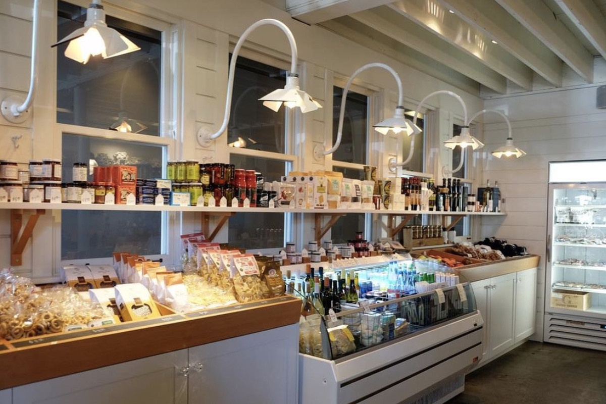 A display case of produce and other pantry goods at The Whale Wins Cafe and Larder