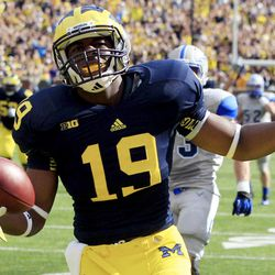 Michigan tight end Devin Funchess (19) celebrates his touchdown during the second quarter of an NCAA college football game against Air Force at Michigan Stadium in Ann Arbor, Mich., Saturday, Sept. 8, 2012.