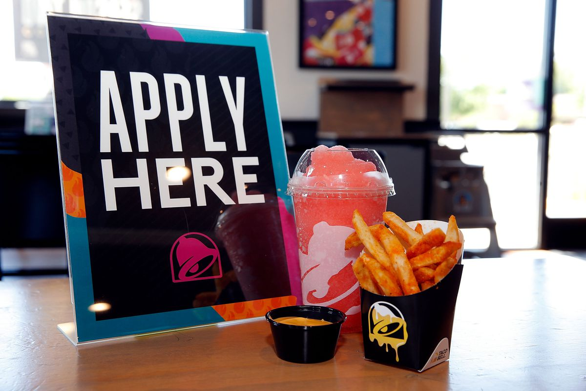 Apply Here sign with Taco Bell food