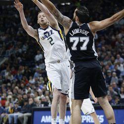 Utah Jazz forward Joe Ingles (2) shoots over San Antonio Spurs center Joffrey Lauvergne (77) in Salt Lake City on Thursday, Dec. 21, 2017.