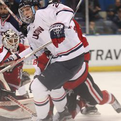 UConn's Tage Thompson (29) watches the puck go into the corner after a shot.