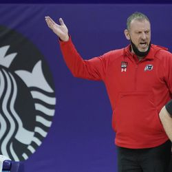 Utah head coach Larry Krystkowiak gestures near the bench during the first half of an NCAA college basketball game against Washington, Sunday, Jan. 24, 2021, in Seattle.