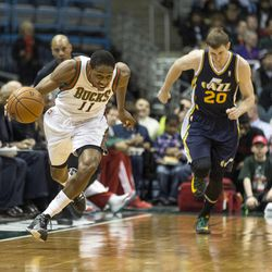 Milwaukee Bucks' Brandon Knight, left, steals the ball intended for Utah Jazz Gordon Hayward during the first half of an NBA basketball game Monday, March 3, 2014, in Milwaukee. (AP Photo/Tom Lynn)