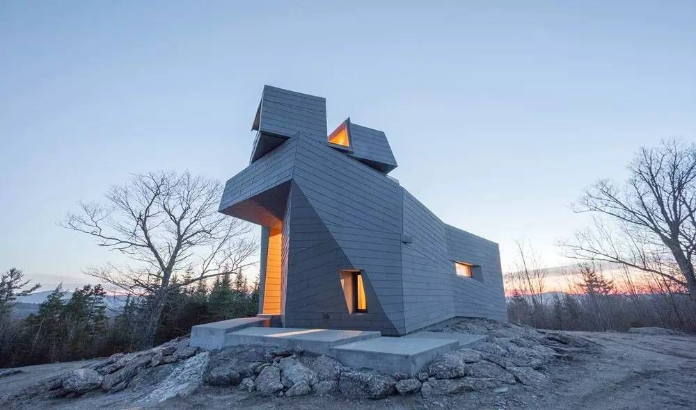 The exterior of Gemma Observatory in New Hampshire. The building structure is geometric with multiple windows.
