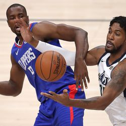Utah Jazz center Derrick Favors (15) battles LA Clippers forward Serge Ibaka (9) for the rebound as the Utah Jazz and LA Clippers play in an NBA basketball game at Vivint Smart Home Arena in Salt Lake City on Friday, Jan. 1, 2021. Utah won 106-100.