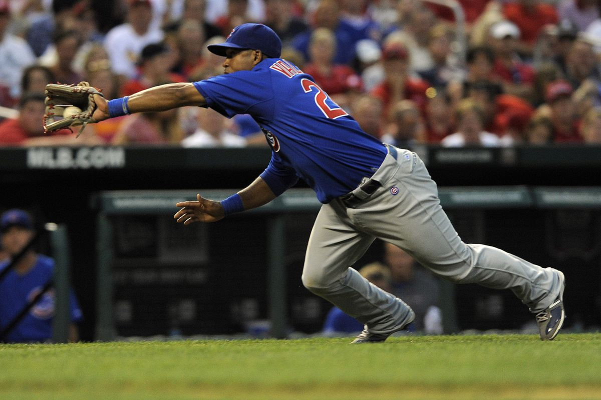 One of the few good plays from Saturday's game: St. Louis, MO. USA; Chicago Cubs third baseman Luis Valbuena dives for a bunt popped up by St. Louis Cardinals center fielder Jon Jay at Busch Stadium. Credit: Jeff Curry-US PRESSWIRE