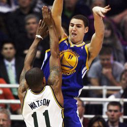 Utah Jazz guard Earl Watson (11) defends Golden State's #11 Klay Thompson as the Utah Jazz and the Golden State Warriors play Friday, April 6, 2012 in Salt Lake City. Jazz won 104-98.