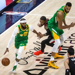 Utah Jazz guard Mike Conley (10) moves with the ball during the game at Vivint Smart Home Arena in Salt Lake City on Thursday, April 8, 2021.