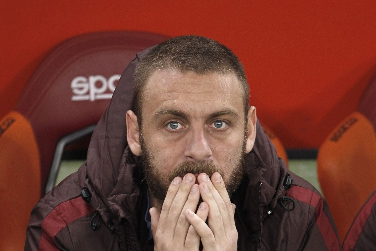 Daniele De Rossi sits on the bench during the Italian Serie...