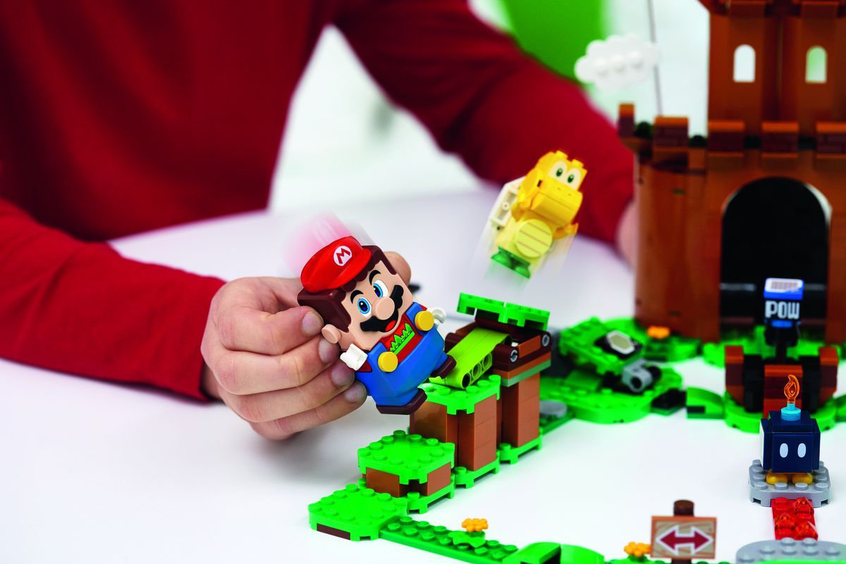 A child playing with Lego Mario