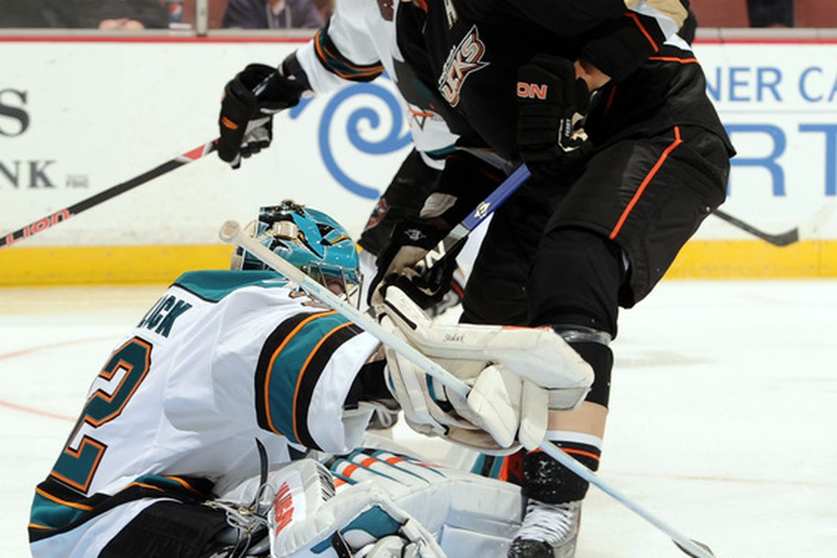 ANAHEIM CA - SEPTEMBER 22:  Corey Perry #10 of the Anaheim Ducks is stopped by Alex Stalock #32 of the San Jose Sharks during the third period at Honda Center on September 22 2010 in Anaheim California.  (Photo by Harry How/Getty Images)