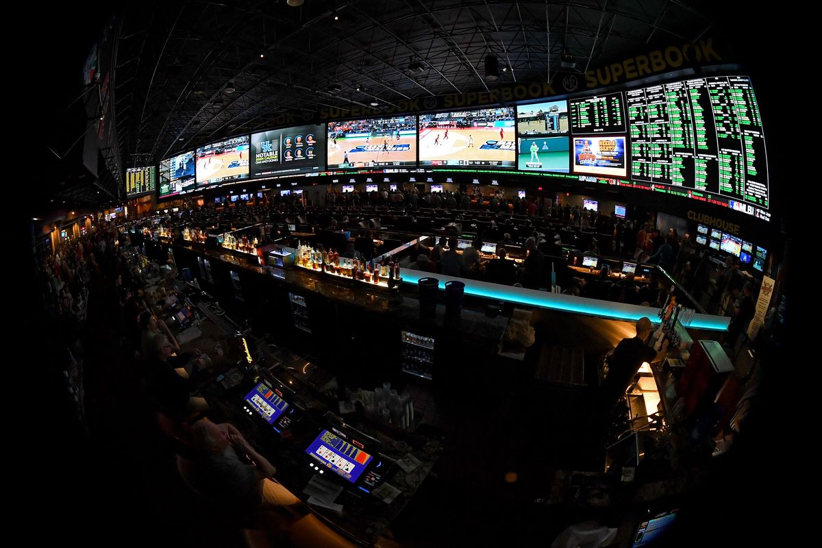 Guests attend a viewing party for the NCAA Men's College Basketball Tournament inside the 25,000-square-foot Race & Sports SuperBook at the Westgate Las Vegas Resort & Casino in Las Vegas, Nevada.