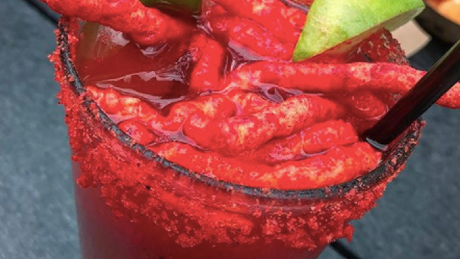 someone spilled flamin hot cheetos in a bloody mary and