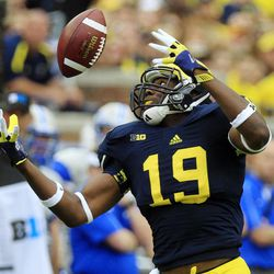 Michigan tight end Devin Funchess (19) pulls in a reception during the second half of an NCAA college football game against Air Force at Michigan Stadium in Ann Arbor, Mich., Saturday, Sept. 8, 2012. Michigan won 31-25.