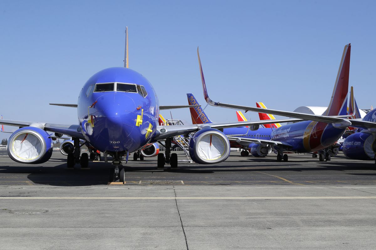 Southwest Airlines airplanes sit parked Tuesday, April 7, 2020, at Paine Field airport in Everett, Wash.