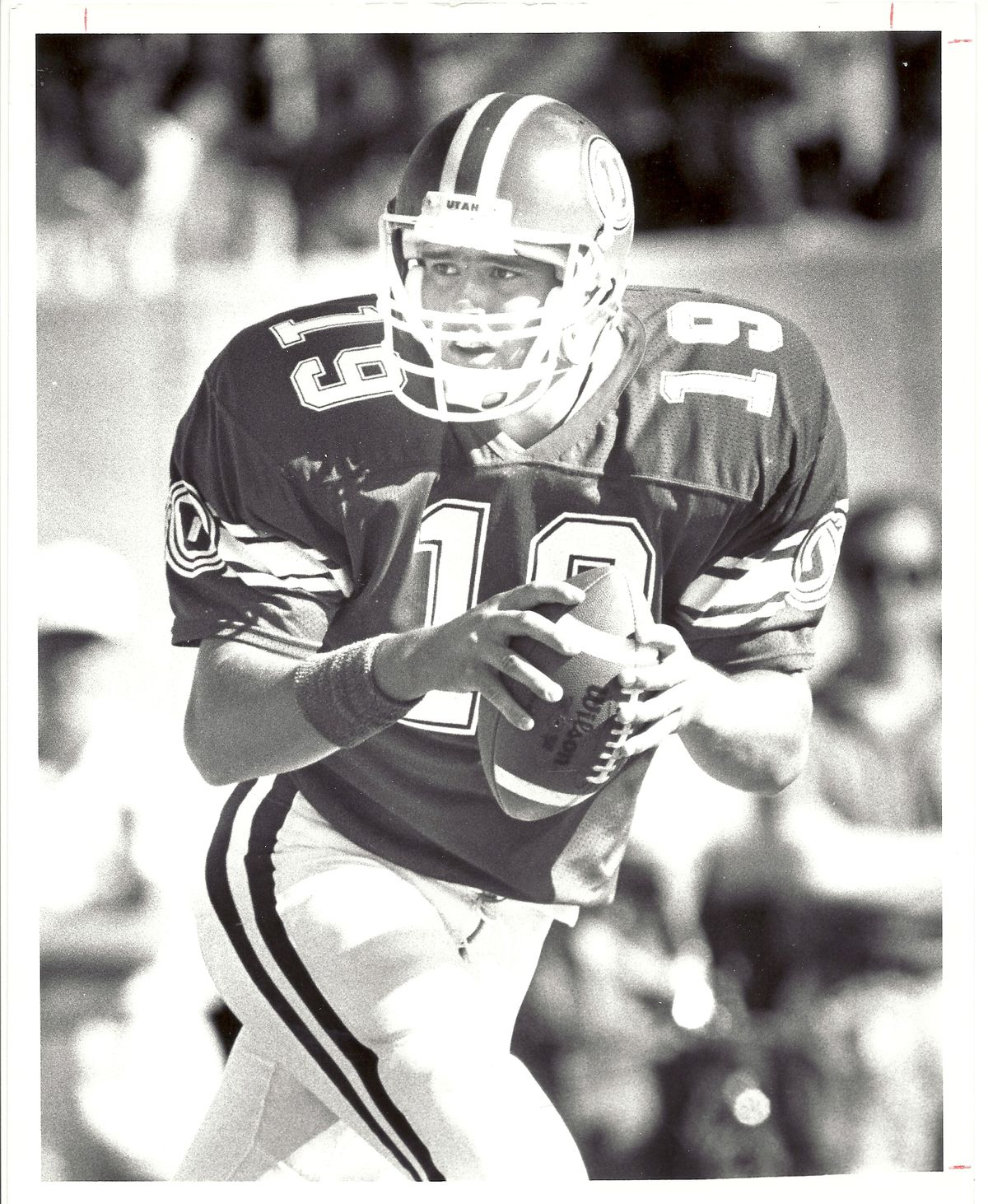 Utah quarterback Scott Mitchell, shown here dropping back to pass, led the Utes to a surprisingly lopsided victory over the Cougars in 1988.