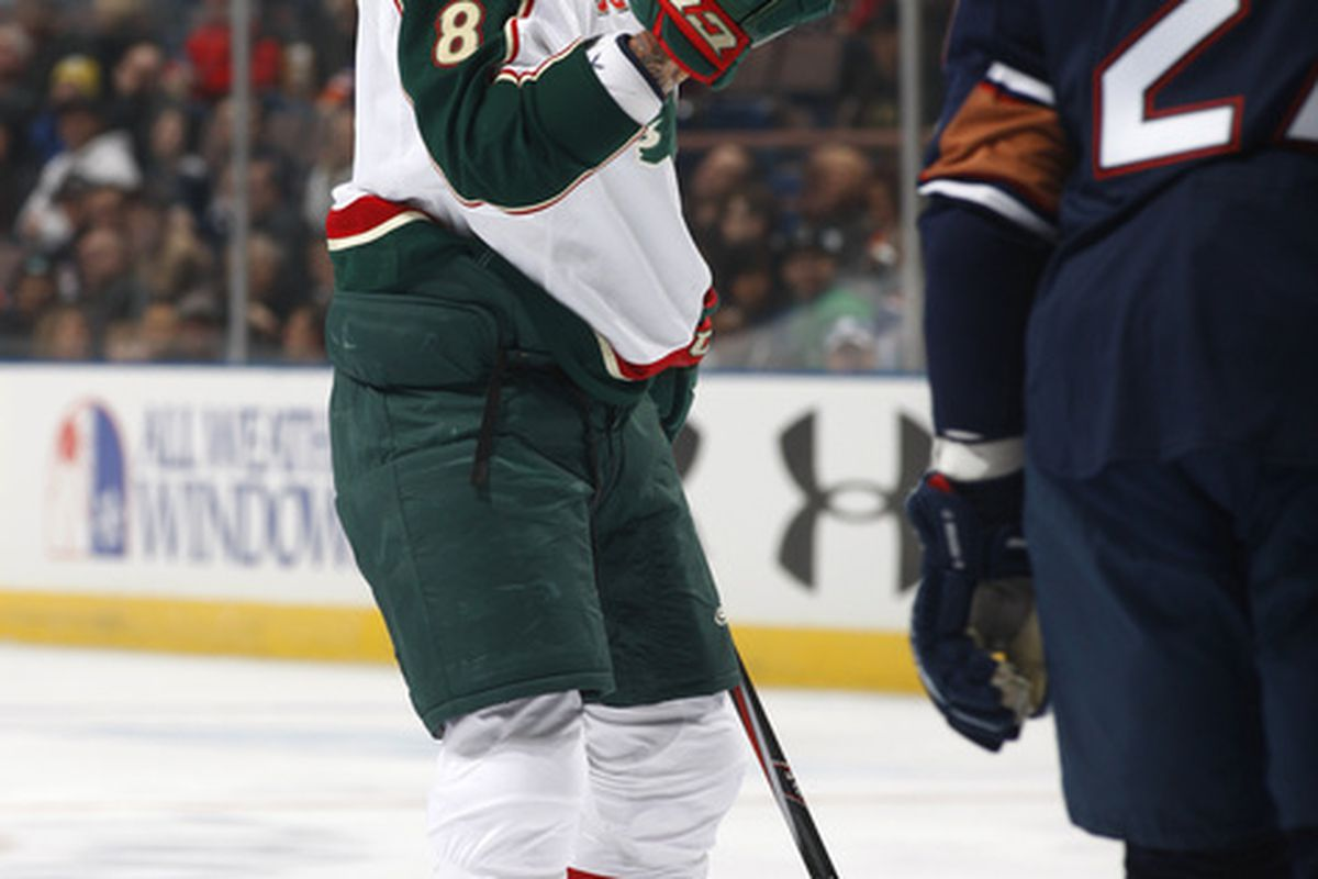 Brent Burns is making a fist, because he is now an enforcer, apparently. (Photo by Dale MacMillan/Getty Images)